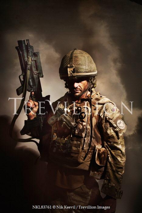 Nik Keevil SOLDIER IN FATIGUES WITH GUN Men