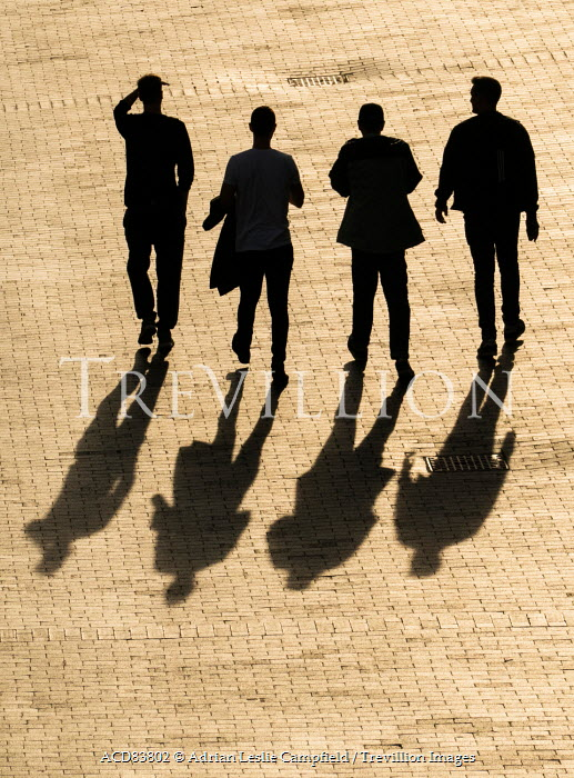 Adrian Leslie Campfield SILHOUETTE OF FOUR MEN ON COBBLED STREET Groups/Crowds