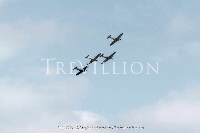 Stephen Mulcahey four 1940s planes flying in blue sky Miscellaneous Transport