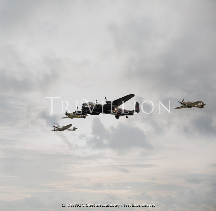 Stephen Mulcahey four 1940s planes flying in cloudy sky Miscellaneous Transport