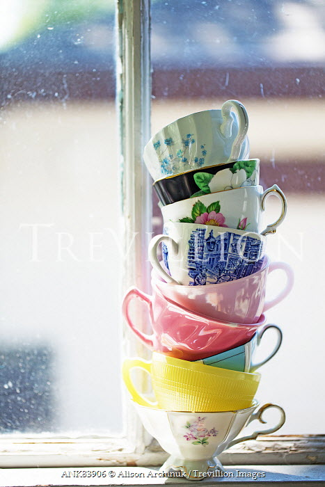 Alison Archinuk PILE OF VINTAGE TEA CUPS BY WINDOW Miscellaneous Objects