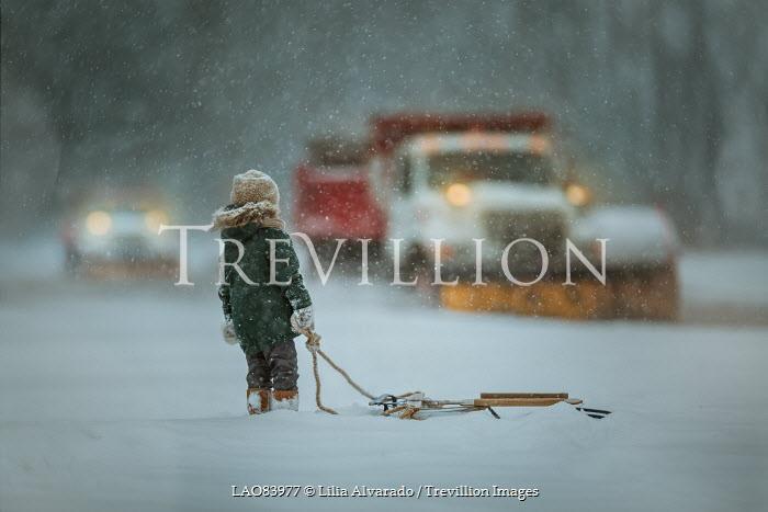 Lilia Alvarado LITTLE BOY WATCHING SNOW PLOWS IN BLIZZARD Children