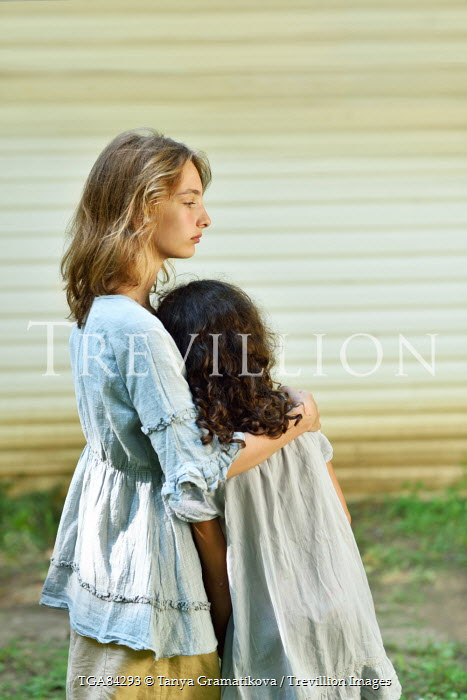 Tanya Gramatikova TWO YOUNG GIRLS EMBRACING IN COOUNTRY Children