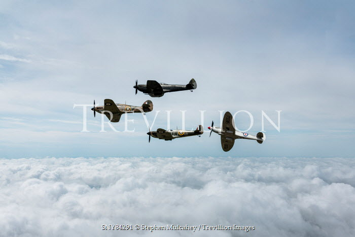 Stephen Mulcahey four 1940s spitfires flying over white clouds Miscellaneous Transport