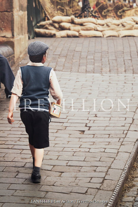 Lee Avison little 1940s boy walking down street Children