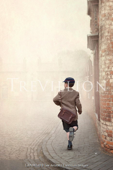 Lee Avison 1940s schoolboy running down a terraced street Children