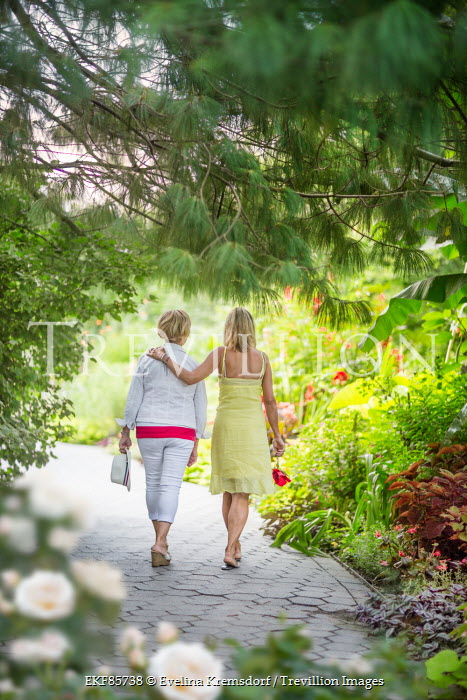 Evelina Kremsdorf TWO BLONDE WOMEN WALKING IN GARDEN Groups/Crowds