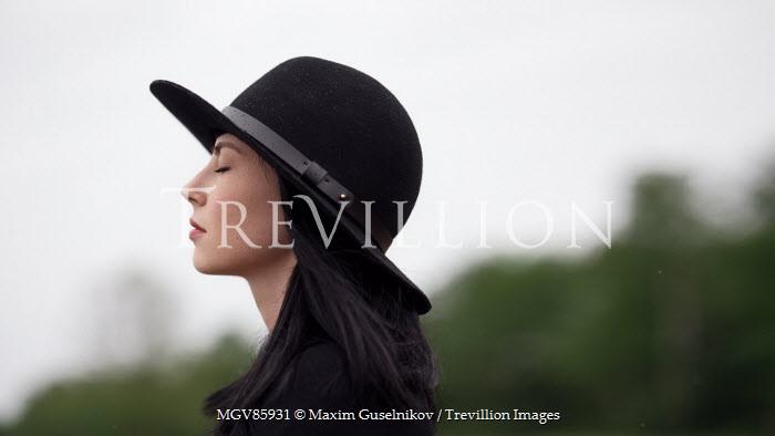 Maxim Guselnikov WOMAN IN HAT DREAMING OUTDOORS Women