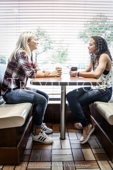 Stephen Carroll TWO TEENAGERS DRINKING COFFEE IN DINER Women