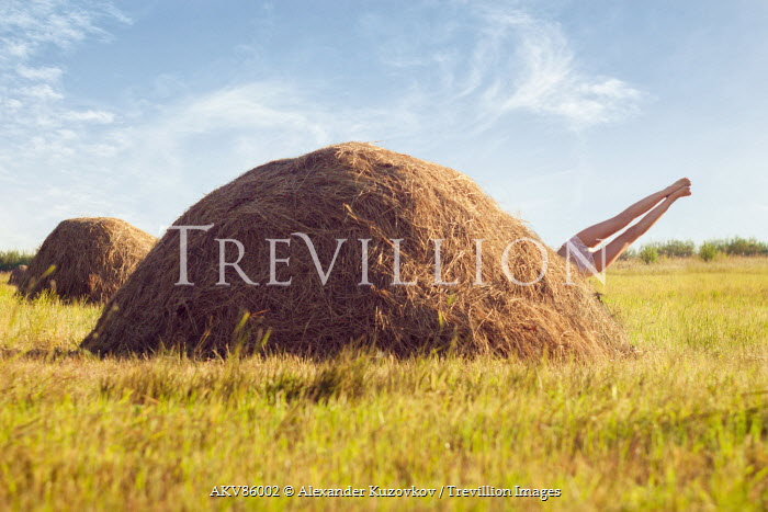 Alexander Kuzovkov WOMAN DIVING INTO HAY BALE Women