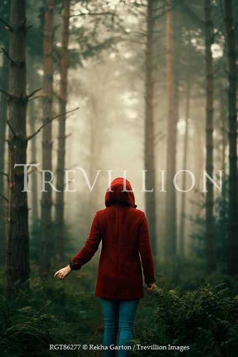 Rekha Garton WOMAN WEARING RED COAT IN FOREST Women