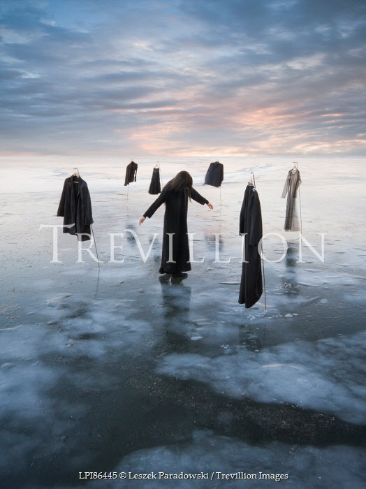 Leszek Paradowski WOMAN WITH SURREAL CLOTHING HANGING OVER FROZEN SEA Women