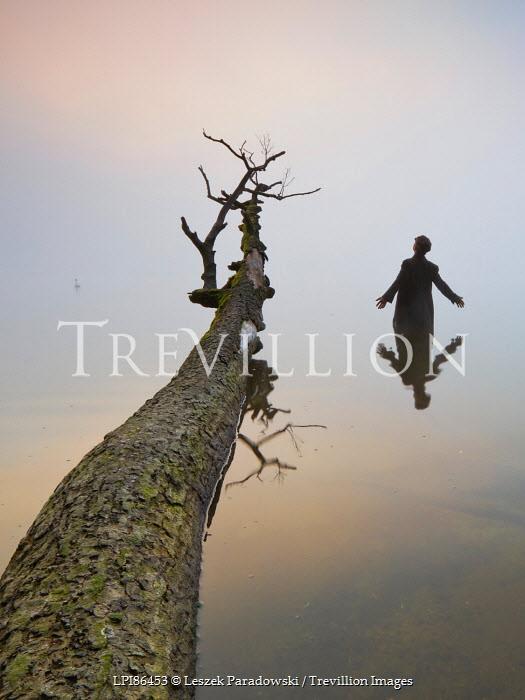 Leszek Paradowski MAN IN WATER WITH FALLEN TREE Men