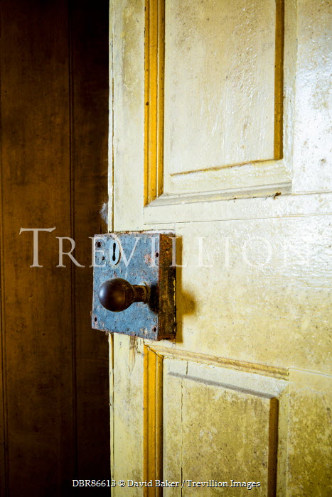 David Baker WOODEN DOOR WITH RUSTED KEYHOLE Building Detail