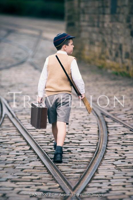 Lee Avison RETRO BOY WALKING WITH TOY GUN AND SUITCASE Children
