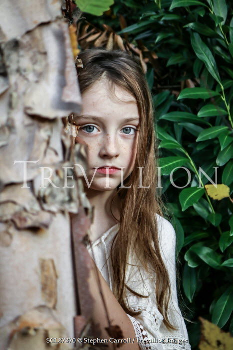Stephen Carroll LITTLE GIRL HIDING BESIDE TREE Children