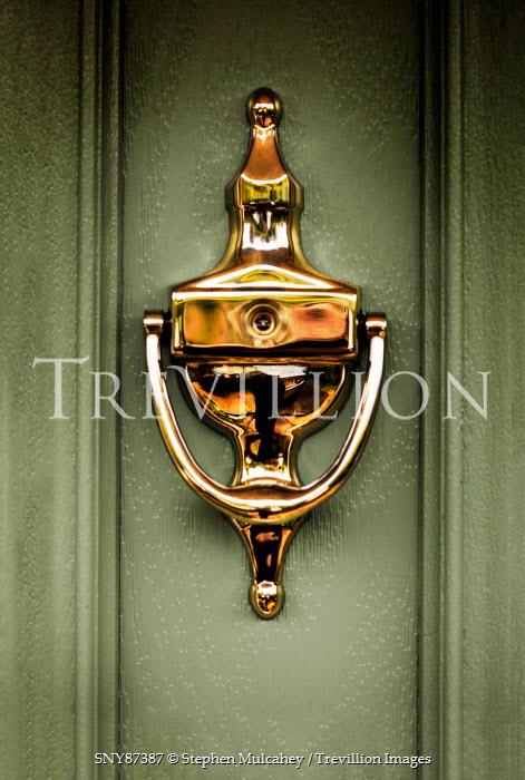 Stephen Mulcahey Gold Door knocker on green door Building Detail