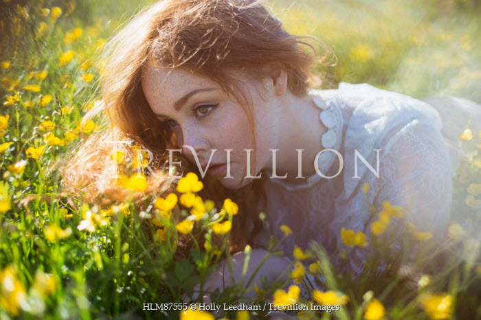 Holly Leedham GIRL WITH RED HAIR LYING IN FIELD OF YELLOW FLOWERS Women