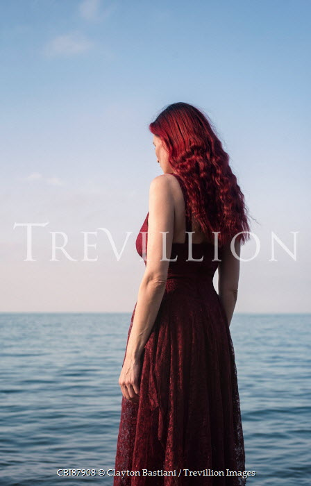 Clayton Bastiani THOUGHTFUL WOMAN WITH RED HAIR BY SEA Women
