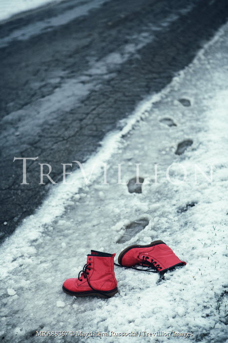 Magdalena Russocka RED BOOTS LYING ON SNOWY ROAD Miscellaneous Objects