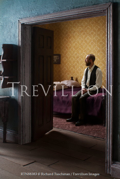 Richard Tuschman RETRO MAN SITTING ON BED IN HOUSE Men