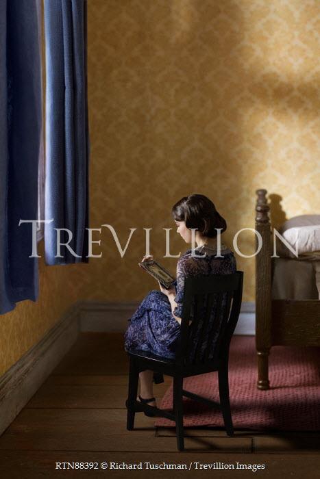 Richard Tuschman RETRO WOMEN SITTING WITH PHOTOGRAPH IN BEDROOM Women