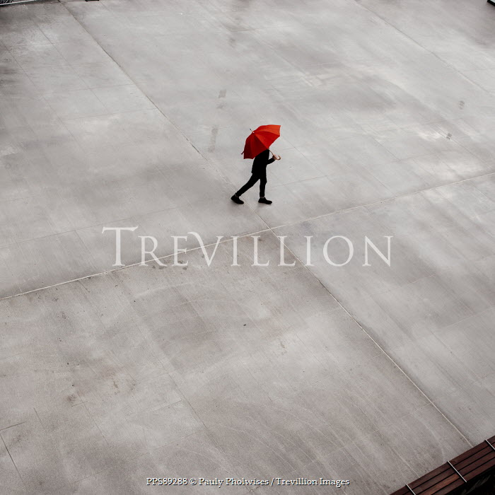 Pauly Pholwises MAN WALKING ON CONCRETE WITH RED UMBRELLA Men