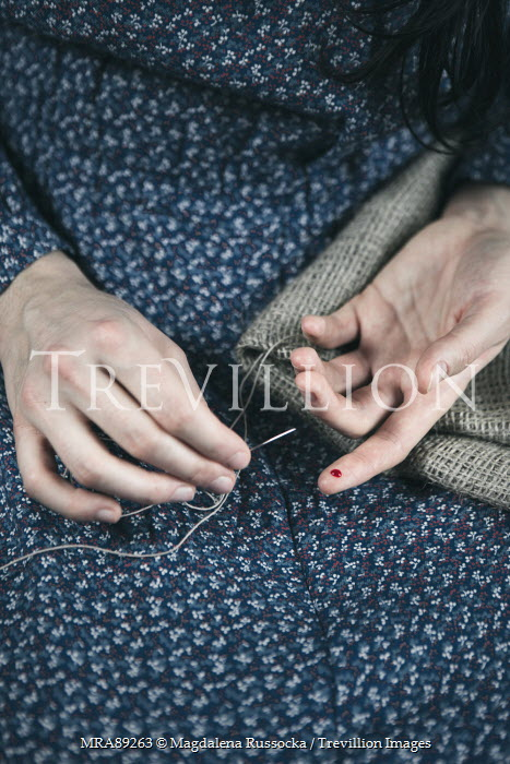 Magdalena Russocka WOMAN SEWING WITH PRICKED FINGER Women