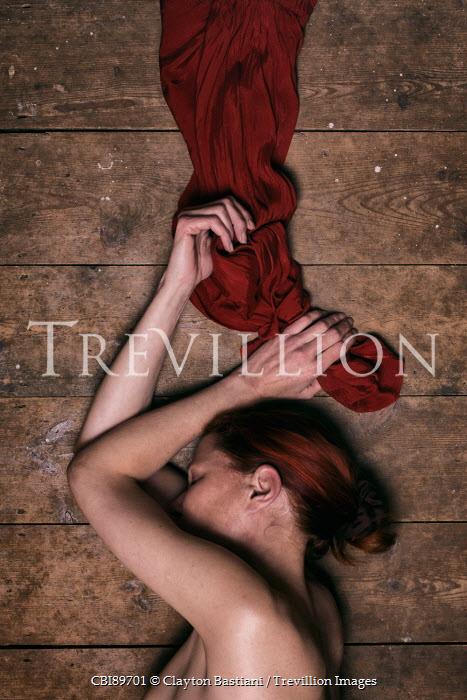 Clayton Bastiani WOMAN LYING ON FLOORBOARDS HOLDING DRESS Women