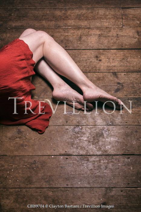 Clayton Bastiani BAREFOOT WOMAN IN DRESS LYING ON FLOORBOARDS Women
