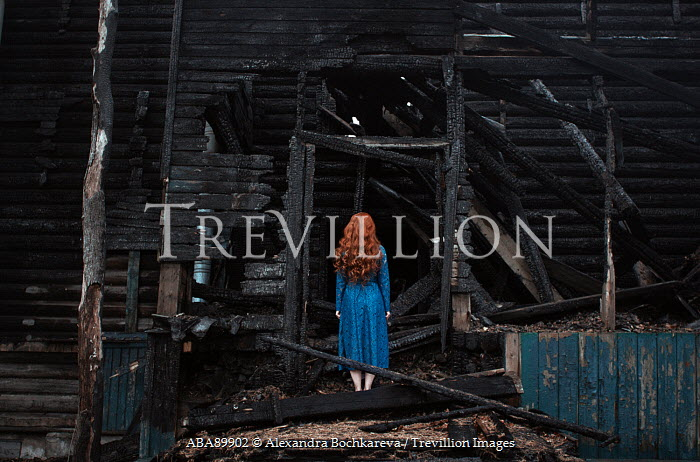 Alexandra Bochkareva WOMAN WITH RED HAIR IN BURNT BUILDING Women