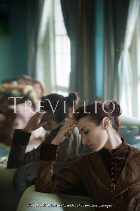 Joshua Sheldon THOUGHTFUL WOMAN SITTING BY MIRROR IN HOUSE Women