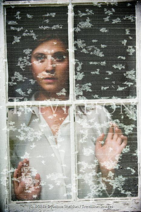 Joshua Sheldon WOMAN WATCHING FROM BEHIND SCREEN AT WINDOW Women