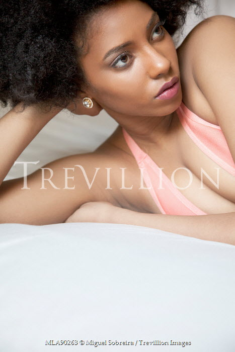 Miguel Sobreira SEDUCTIVE WOMAN WITH AFRO LYING ON BED Women