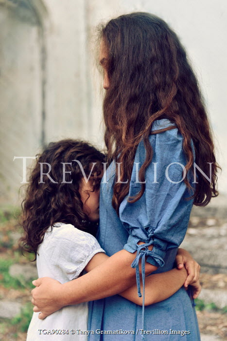 Tanya Gramatikova LATIN MOTHER HUGGING DAUGHTER OUTDOORS Women