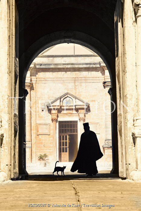 Yolande de Kort SILHOUETTED MONK AND CAT IN GRAND BUILDING Men