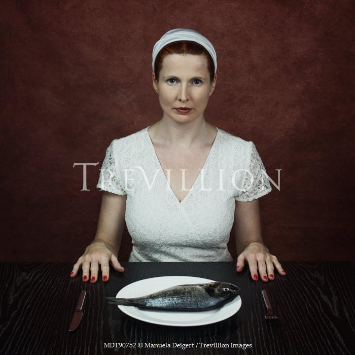 Manuela Deigert WOMAN WITH FISH ON PLATE Women