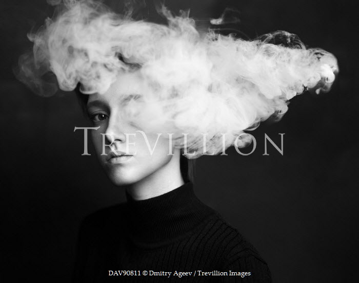 Dmitry Ageev YOUNG WOMAN WITH SMOKE IN FRONT OF FACE Women