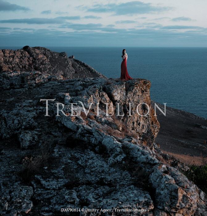 Dmitry Ageev WOMAN STANDING ON ROCKS BY SEA Women