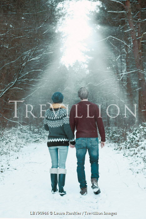 Laura Ranftler COUPLE WALKING IN SNOW Couples