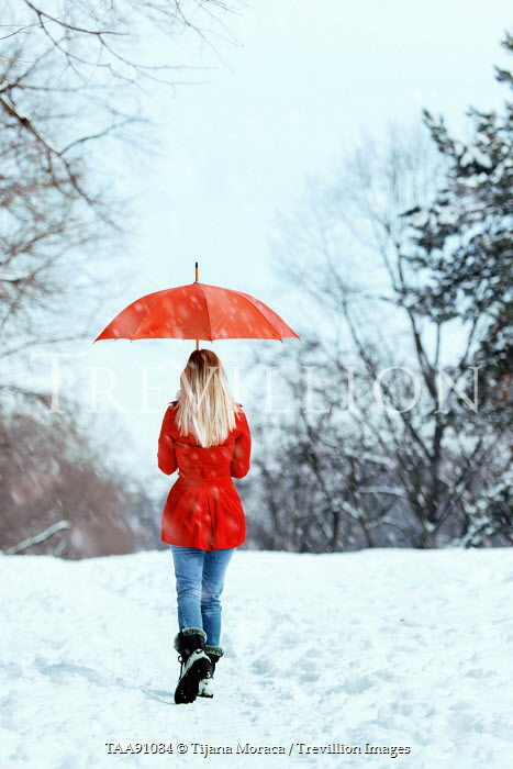 Tijana Moraca YOUNG WOMAN IN SNOW WITH UMBRELLA Women
