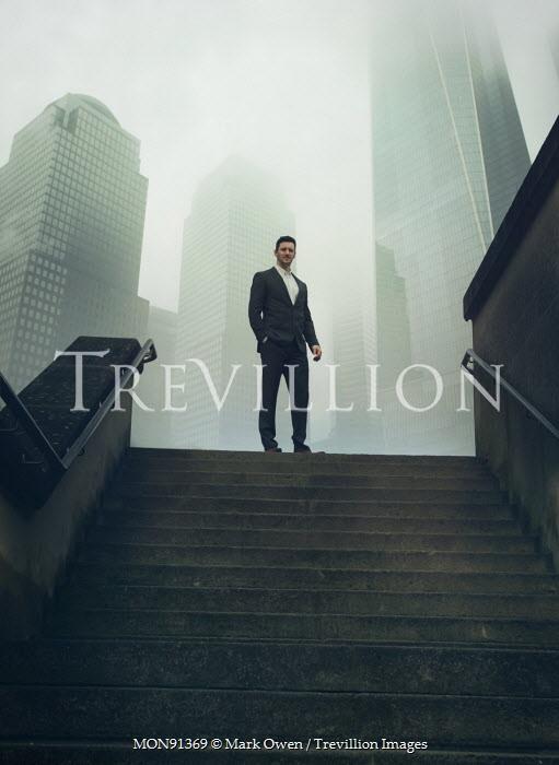 Mark Owen MAN IN SUIT ON CITY STEPS Men