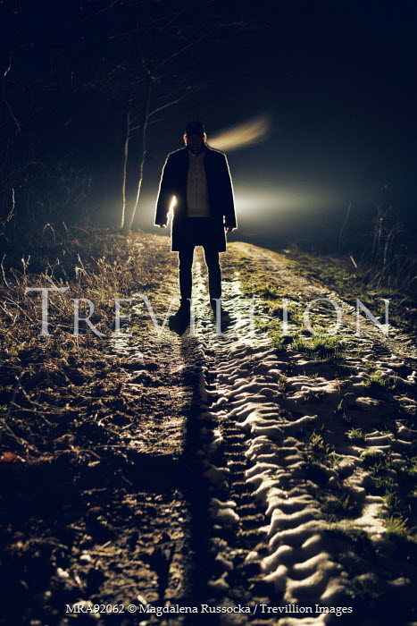 Magdalena Russocka MAN STANDING ON COUNTRY ROAD AT NIGHT Men
