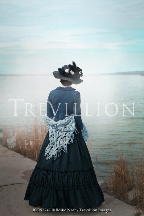 Ildiko Neer Victorian woman standing at lake Women