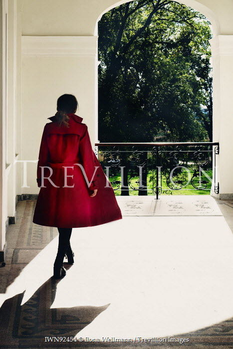Ilona Wellmann GIRL IN RED COAT WALKING ON BALCONY Women