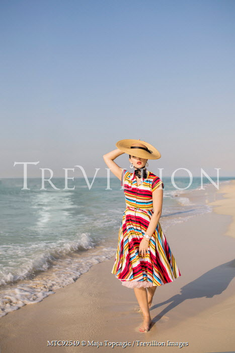 Maja Topcagic RETRO WOMAN WEARING HAT ON BEACH Women