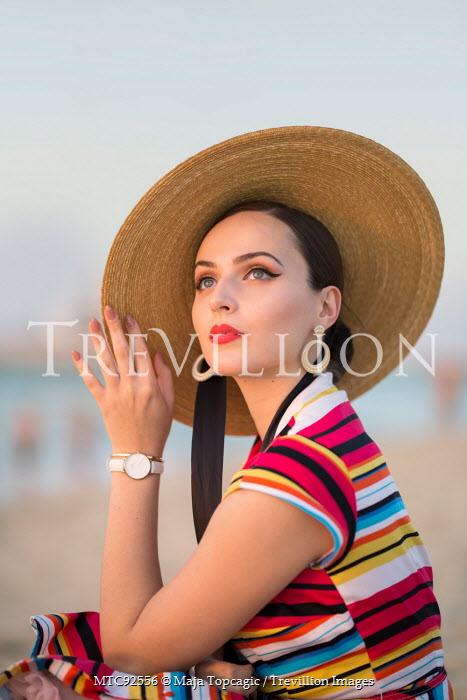 Maja Topcagic WOMAN IN HAT AND STRIPY DRESS ON BEACH Women