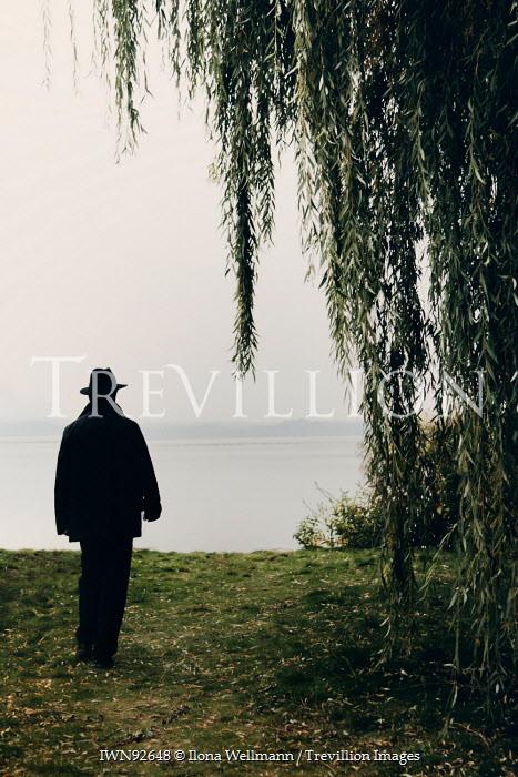 Ilona Wellmann MAN BY TREE WATCHING SEA Men