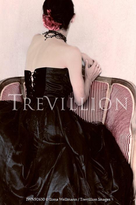 Ilona Wellmann HISTORICAL WOMAN IN BLACK SITTING ON CHAIR Women
