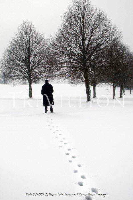 Ilona Wellmann MAN IN SNOWY FIELD WITH TREES Men